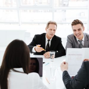 graphicstock-business-people-sit-by-the-table-in-conference-room_BUTI_DXOnl-squashed